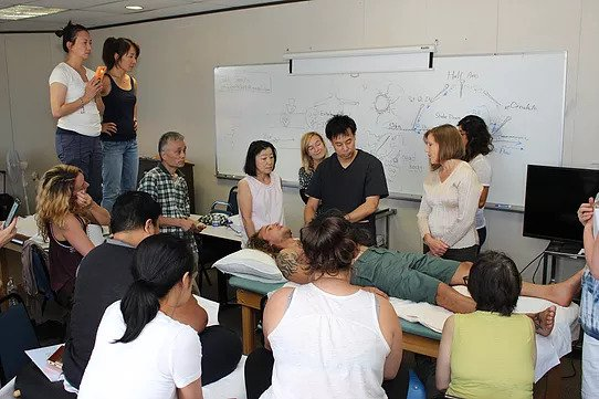 Funamizu teaching students at AIMC