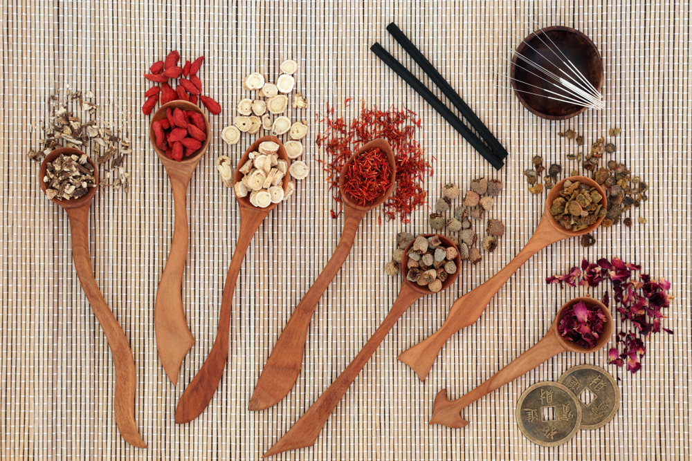Chinese medical herbal medicine in wooden spoons
