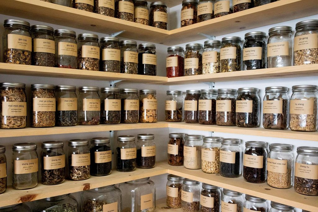 Jars full of wellness foods on a wall from the San Francisco Chronicle.